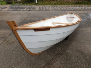 Small sailing boat or row boat to be carried on our roof rack.