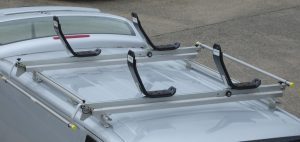 Roof rack for kayaks, with J cradles