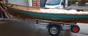 Skiff single with launch trolley