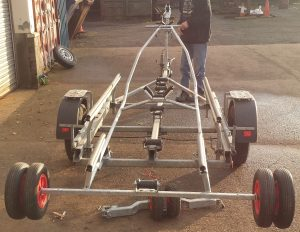 Pull the trolley on to the trailer, with the skiff on the trolley this is made easier using the bow post winch