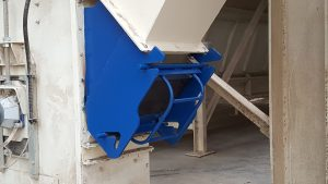 Animal feed transfer chute with integral magnet