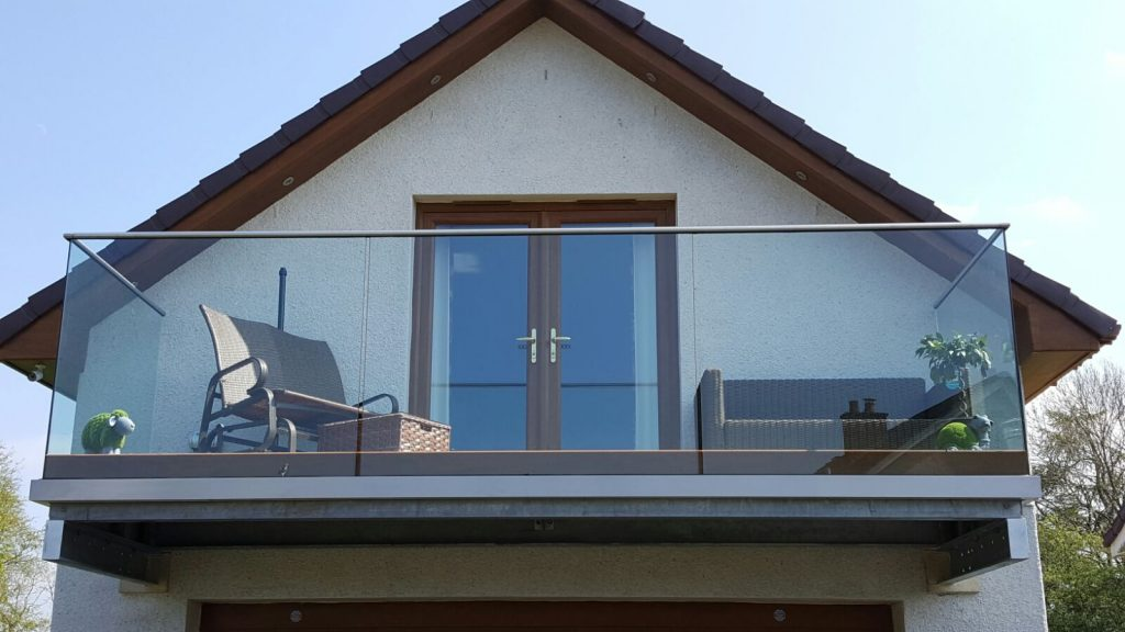Balcony complete with toughened glass balustrade