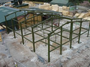 New portal frame including floor steel for reconstruction works of a roundwood timber mill